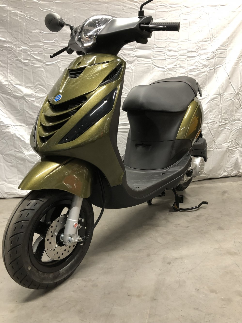 tensen-tweewielers-westland-scooter-winkel-shop-dealer-van-piaggio-kymco-vespa-tomos-emco-post-nl-scootertransport-opslag-magazijn-betrouwbaar-werkplaats